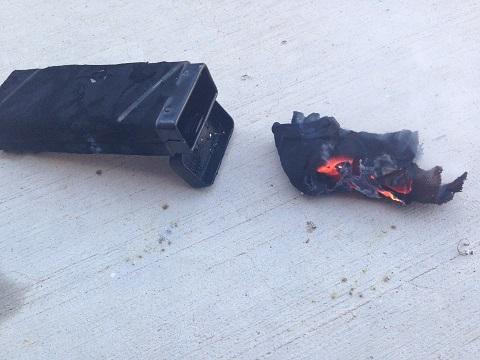 tin and burning char cloth