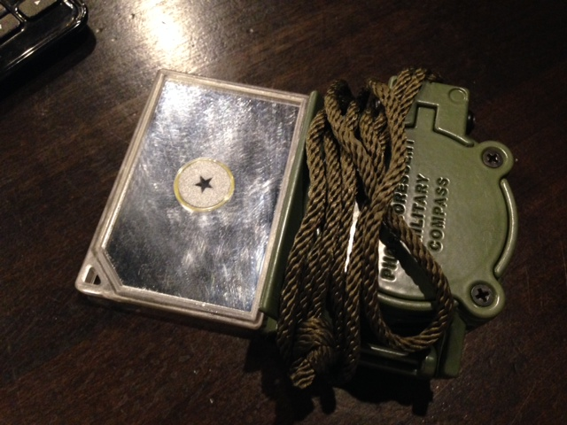 Army lensatic compass and signal mirror